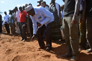 Honourable Ali Wario, Member of Parliament, Bura planting cotton seed at the project launch
