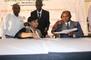 KAAA CEO Lucy Muchoki and Kilifi County Governor Hon. Jefferson Kingi sign an agreement during the KIIF at Pwani University.