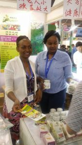 KAAA Youth and SME Coordinator Jane Mwangi (right) with an SME at the Expo