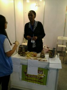 A KAAA SME at her stand at the Guangdong Expo in China